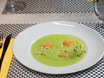 Cream soup with lightly salted salmon and almonds