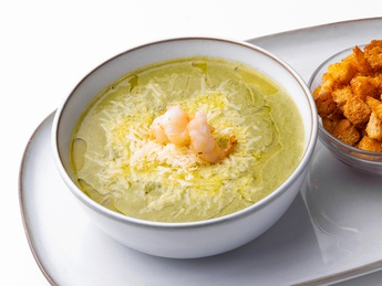 Spinach soup with shrimp and parmesan