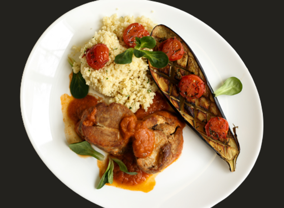 Baked pork neck with eggplant and couscous