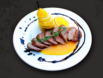 Duck breast in orange sauce with caramelized pear
