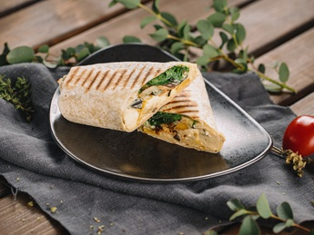 Wrap with hummus and cooked vegetables