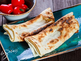Grilled lavash with double cheese and tomato