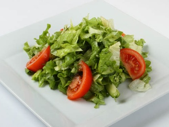 Green salad in vinaigrette sauce