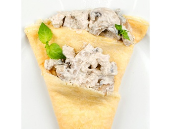 Pancake with chicken and mushrooms in a creamy sauce