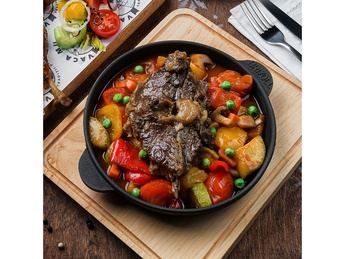 Stewed vegetables with stewed young lamb on bone