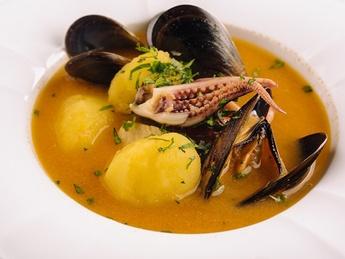 Fish soup Bouillabaisse with prawns