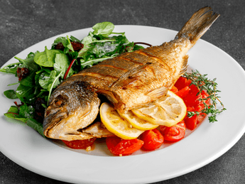Gold fillet with tomatoes and olives