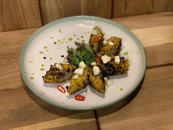 Grilled corn with parmesan oil