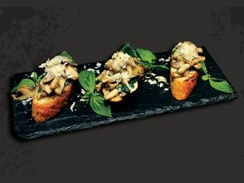 Bruschetta with mushrooms, parmesan and basil
