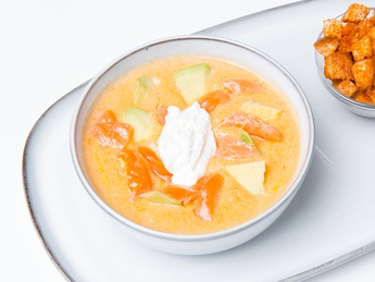Cream soup with salmon and avocado
