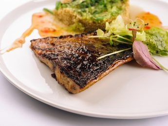Asian-style baked carp fillet with sesame seeds