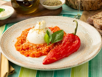 Burrata with baked peppers on a vegetable pillow
