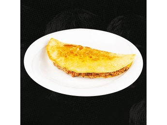 Homemade omelet stuffed with bolognese stew