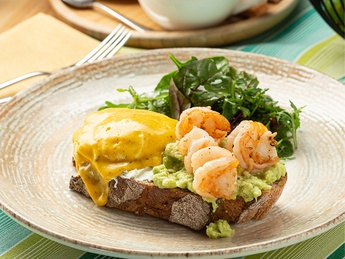 Grand toast with guacamole and tiger prawns