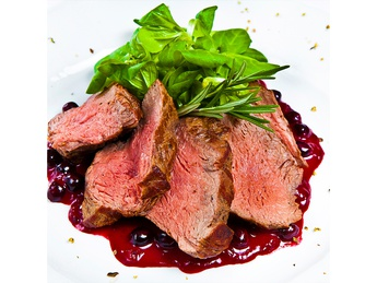 Veal with berry sauce with baked potatoes