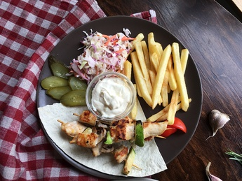 Chicken bbq with  fries potatoes, salad and sauce