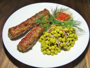 Mici with pea salad