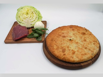 Ossetian pie with veal and fresh cabbage