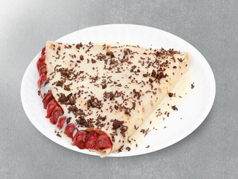 With condensed milk and cherries