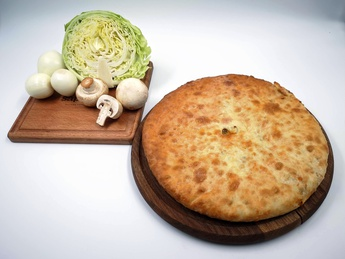 Ossetian pie with fresh cabbage and mushrooms