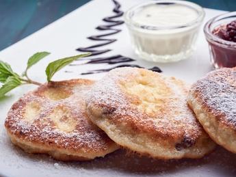 Papanasi with sour cream and jam