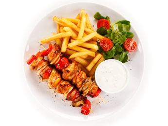 Menu with chicken skewers and salad